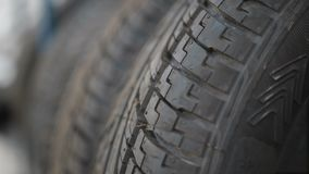 Car tyres at warehouse in tire store stock video footage