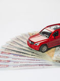 Car and UAE Dirham. A toy car on the stack of UAE Dirham notes Royalty Free Stock Photo
