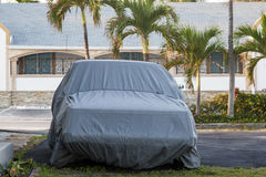 Car under a car cover Stock Images