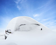 Car under deep snow in winter day Royalty Free Stock Photography