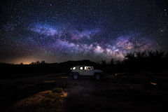 Car under the milky way Royalty Free Stock Image