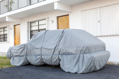 Car under a protective cover Royalty Free Stock Photos