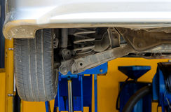Car under repair on hoist at service station Royalty Free Stock Photo