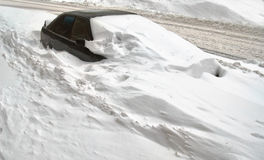 Car under snow. The car is partially covered with snow Royalty Free Stock Photos