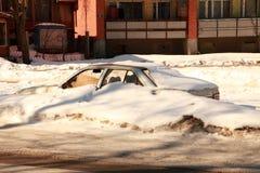 Car under snow. Car with broken window under snow Stock Images