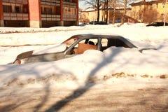 Car under snow. Car with broken window under snow Stock Photos