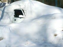 The car under the snow. Royalty Free Stock Photos