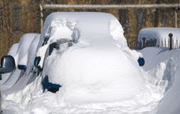 Car under snow. Parked car covered and stuck in snow royalty free stock photography