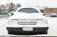 Car under the snow. Parked car under the snow royalty free stock images