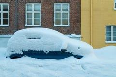 Car under snow. Baklandet street in Trondheim stock photos