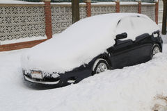 Car under snow in Brooklyn, NY after massive Winter Storm Juno strikes Northeast. Royalty Free Stock Images