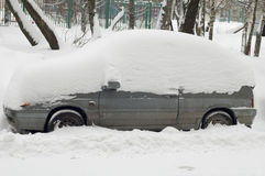 Car under snow in city Moscow Stock Images