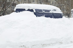 The car under snow in the city Moscow Stock Photo