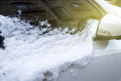 Car under the snow close-up side view stock photography