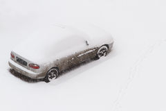 Car under the snow. Copy space included Stock Photo