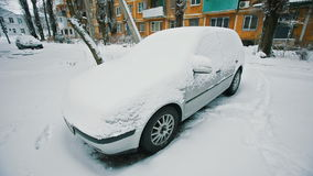 Car under snow stock video