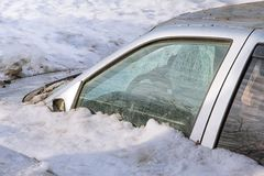Car under the snow disaster. Royalty Free Stock Photo