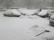 Car under snow, Natural disasters winter, blizzard, heavy snow paralyzed the city, collapse. Snow covered the cyclone Europe Stock Photography