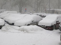 Car under snow, Natural disasters winter, blizzard, heavy snow paralyzed the city, collapse. Snow covered the cyclone Europe Stock Image