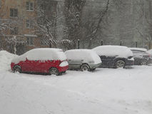Car under snow, Natural disasters winter, blizzard, heavy snow paralyzed the city, collapse. Snow covered the cyclone Europe Stock Photos