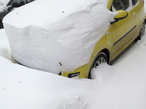 Car under snow, Natural disasters winter, blizzard, heavy snow paralyzed the city, collapse. Snow covered the cyclone Europe Stock Images