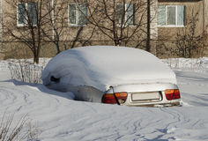 Car under snow on parking Royalty Free Stock Photography