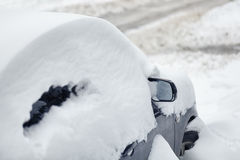 Car under snow after snowfall Royalty Free Stock Image
