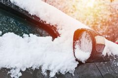 Car under snow in winter, close-up to mirror royalty free stock image