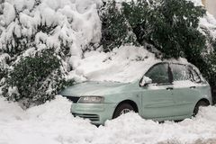 Car under the snow. Winter weather specific royalty free stock photo