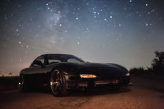 Car under stars. Car under milky way galaxy Royalty Free Stock Images