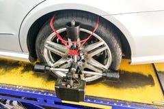 Car undergo wheel align in garage Stock Photo