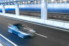 Car in underground highway tunnel Stock Photos