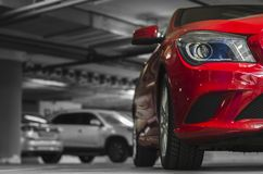 Car on the underground parking. Side of red car on the underground parking Stock Photos