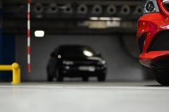 Car on the underground parking. Side of red car on the underground parking Royalty Free Stock Photo