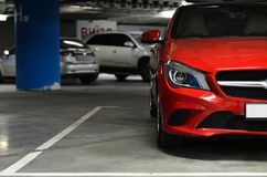 Car on the underground parking. Side of red car on the underground parking Royalty Free Stock Image