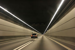 The car in the undersea tunnel. Fast car in the undersea tunnel Royalty Free Stock Photos