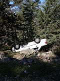 Car upside down between trees. Jerusalem forest traffic accident Stock Photo