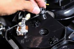 Car user open the battery cap Stock Image