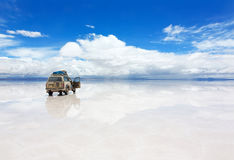 Car on the Uyuni Salar in Bolivia. Car on the reflected surface of Salar de Uyuni lake in Bolivia Stock Photos