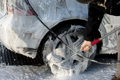 Car valet. Dirty silver car covered in suds, being valeted Stock Images