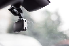 Car video recorder installed on front window, close up photo Stock Images