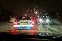In car view of snow fall storm in the UK causes traffic congestion at night royalty free stock images