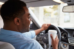 In car view of young male African American driving a car Stock Images