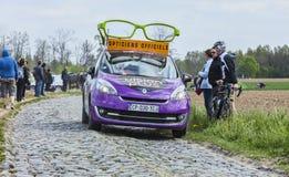 The Car of Vision Plus. Carrefour de l'Arbre,France-April 13,2014: The car of Vision Plus during the passing of the Publicity Caravan before the apparition of Stock Photo