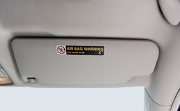 Car Visor. Gray car visor with air bag warning Stock Images