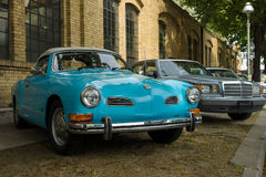 Car Volkswagen Karmann Ghia (foreground) and the Mercedes-Benz W201 (background) Stock Images