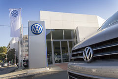 Car with Volkswagen logo in front of dealership building. PRAGUE, CZECH REPUBLIC - OCTOBER 1: Car with Volkswagen logo in front of dealership building on October Stock Photography