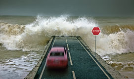 Car vs wave Stock Photography