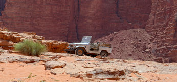 Car in the Wadi Rum Desert -- also known as The Valley of the Moon is a valley cut into the sandstone and granite rock in southern Royalty Free Stock Images