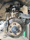 Fix. The car wait on maintenance and fix brake discs in car service garage royalty free stock photos